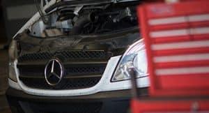 A Mercedes Sprinter van being serviced in Gus Commercials' maintenance workshop