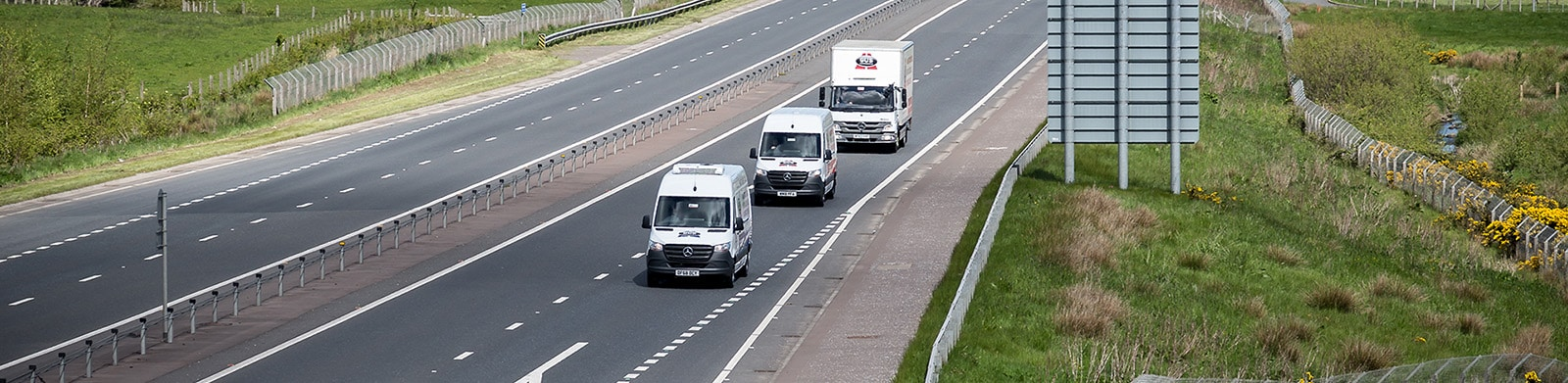 Three Gus Commercials hire vehicle being driven on roads in Northern Ireland