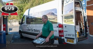 Craig Foods Delivery Driver Delivering Slemish Bakery Goods to a Store Using a Van Supplied by Gus Commercials