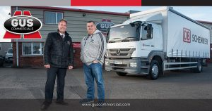 Owner Operator for DB Schenker in Mallusk, Hugh Burns, accepting delivery of a truck from Eric Magill of Gus Commercials