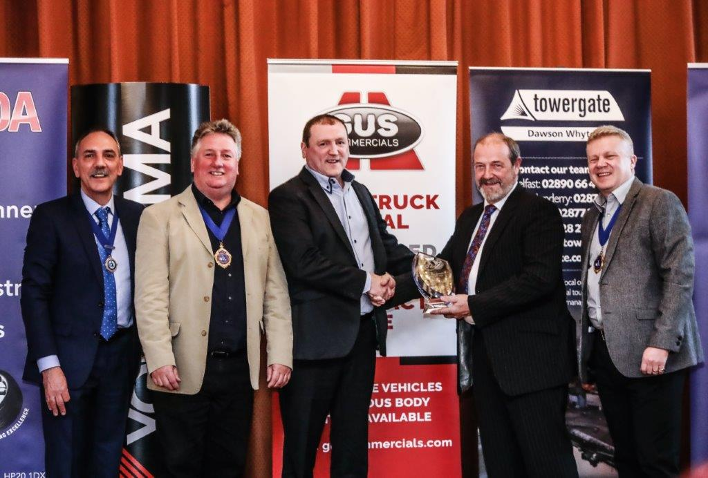 Billy Miskelly of Gus Commercials presenting the Tyre Manufacturer of the Year award to Derek Hill of Tyre Call Antrim at the 2019 National Tyre Distributors Association NI annual ceremony